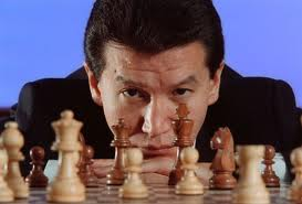 Russian head of world chess Ilyumzhinov says Gaddafi told him he was in Tripoli…